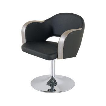 siège de coiffure noir et argenté style underground avec pied rond en métal brillant