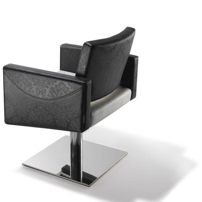 chaise de coiffeur noir et blanc avec pompe hydraulique
