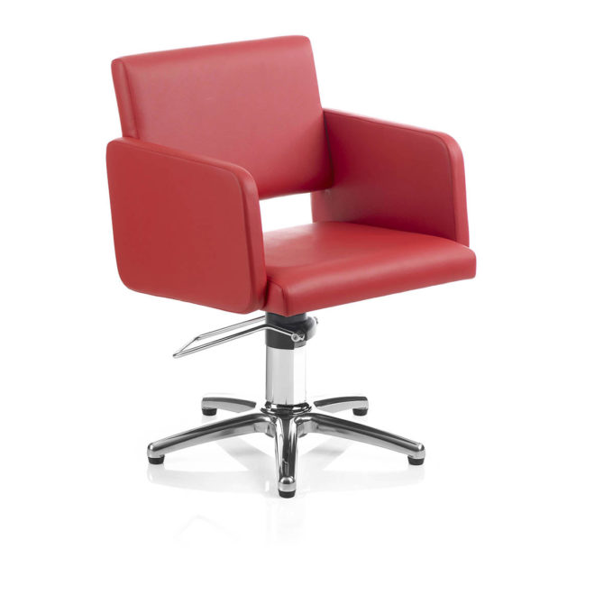 Siège de coiffure rouge carmin avec pied étoile et pompe hydraulique, design moderne