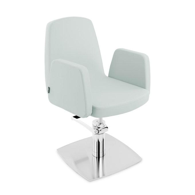 Fauteuil de coiffure bleu clair avec assise large et dossier haut en mousse épaisse et skai, pied carré en métal