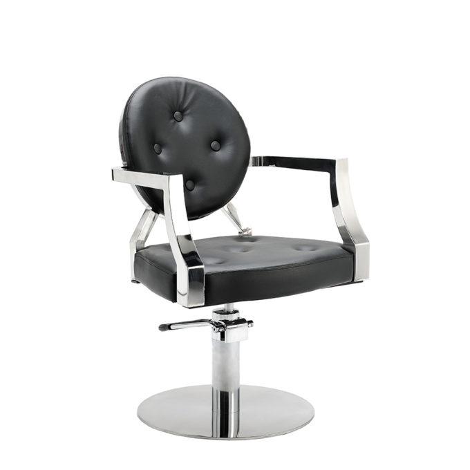 Fauteuil vintage assise et dossier en pvc noir capitonné avec finitions chromées