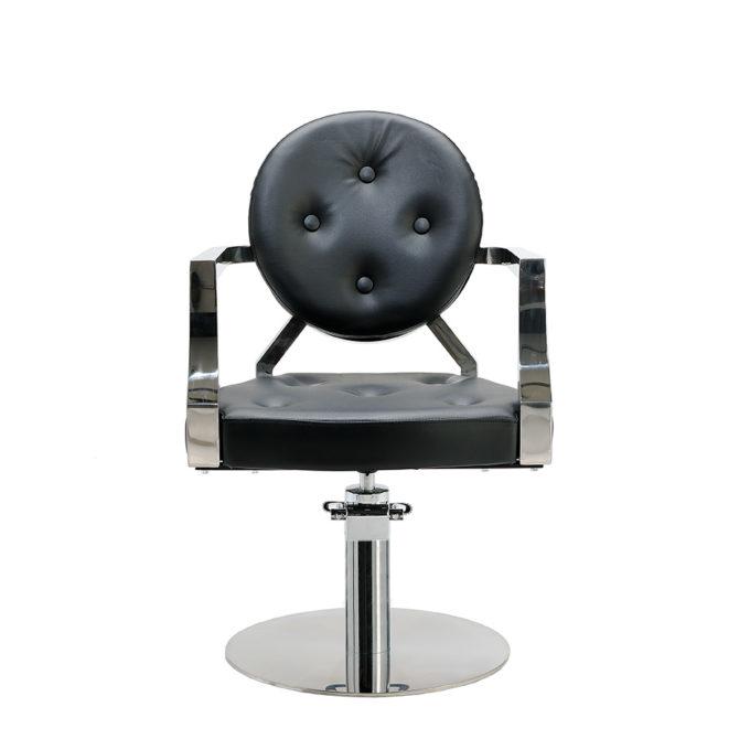 fauteuil noir vintage de coiffure avec pied rond et finitions chromé