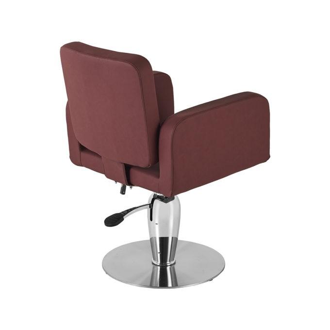 Fauteuil de coiffeur rouge foncé avec assise large et pied rond en métal brillant