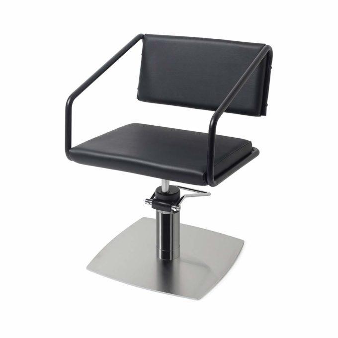 Fauteuil de salon de coiffure structure en acier noir avec assise en similicuir et pied en métal brillant