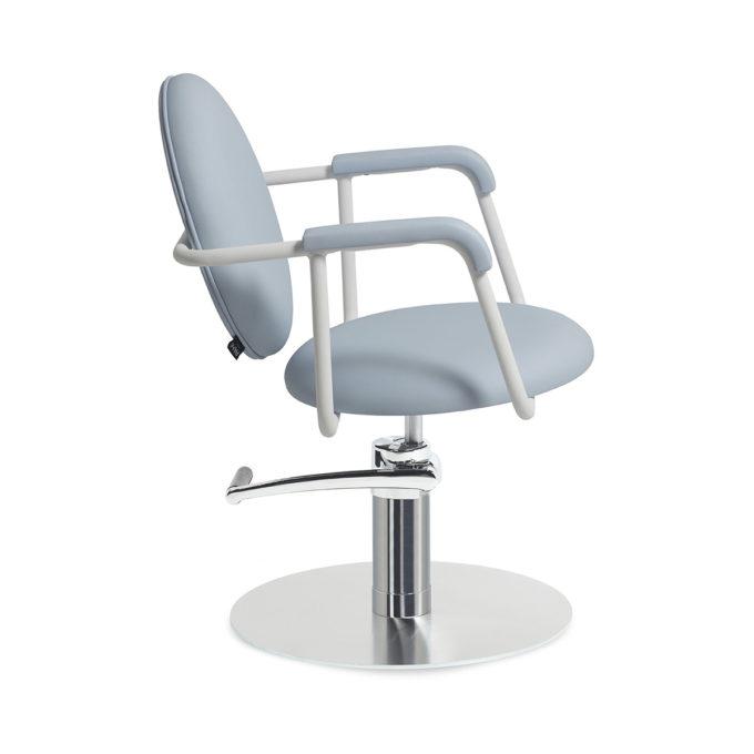 fauteuil de coiffure bleu et pied en métal rond