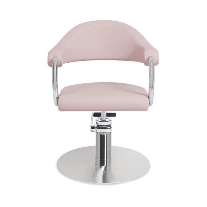 fauteuil de coiffure rose pastel avec accoudoir et contour en métal brillant