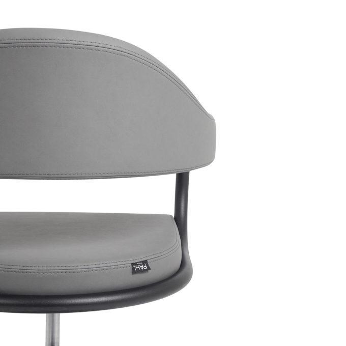fauteuil original de coifffure avec contour en métal noir
