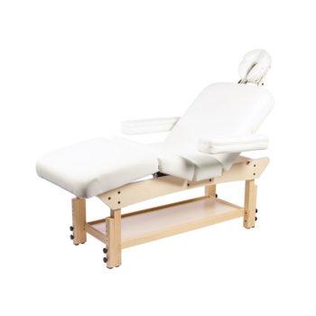 Lit de massage en bois clair avec accoudoir et repose jambes réglables