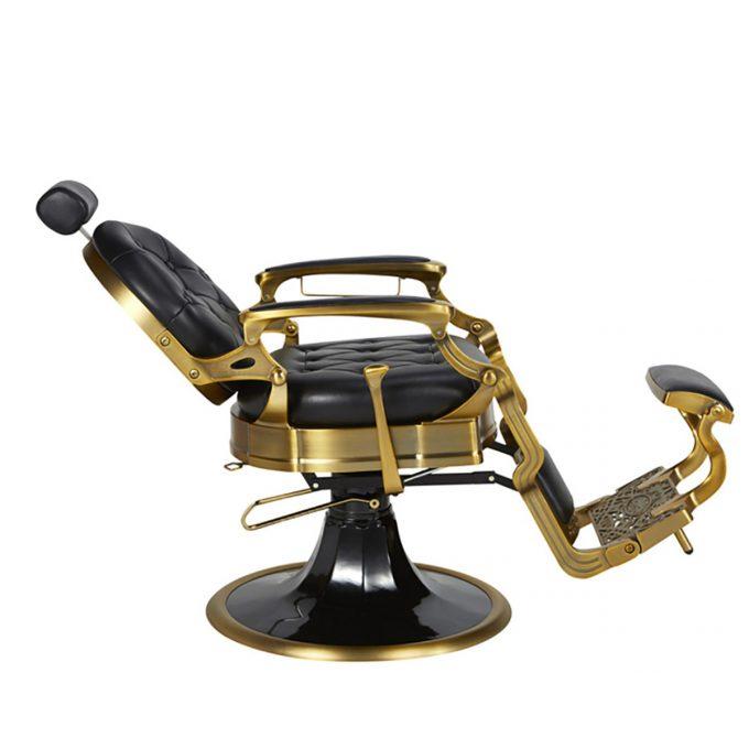 fauteuil de barbier noir et or avec repose pieds et tête accoudoirs